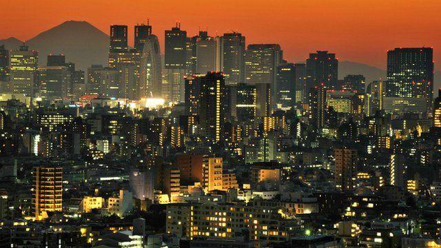 Mount Fuji behind the skyline of the Shinjuku area of Tokyo at sunset