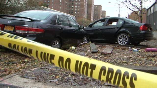 Two cars damaged by super-storm Sandy on Avenue C