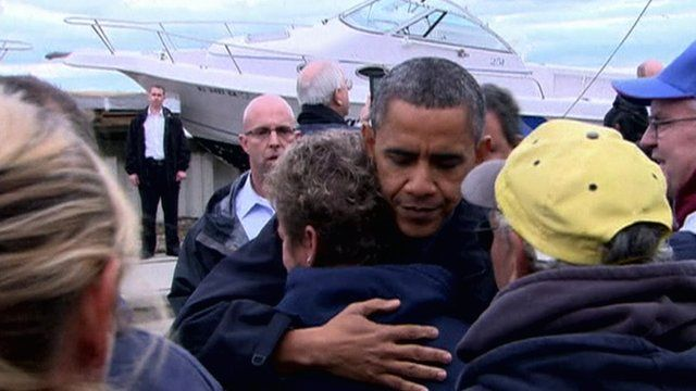 President Obama comforts a resident in New Jersey