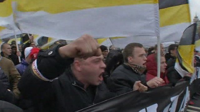 Russians march with banners and flags