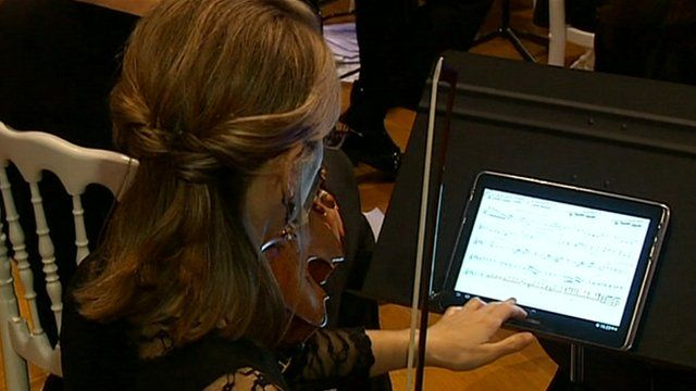 A musician using the tablet computer during a performance