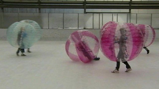 Children playing ice football