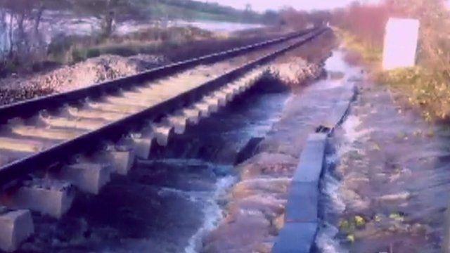 Broom rail crossing