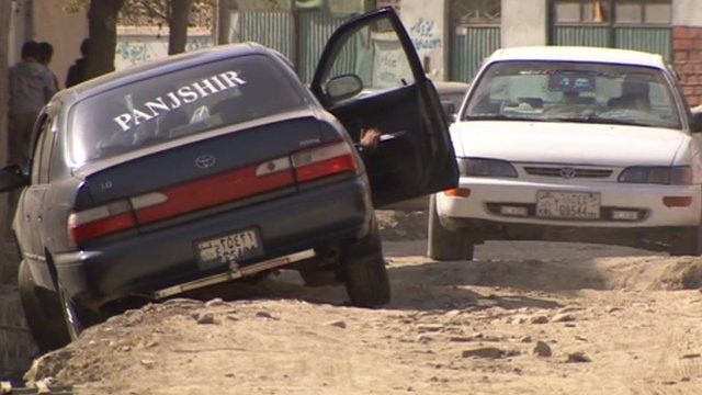 Car driving over unfinished road in Kabul
