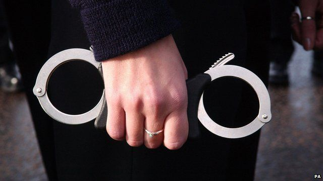 police officer holding handcuffs