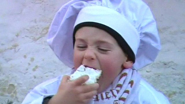 Boy eats a piece of Stollen