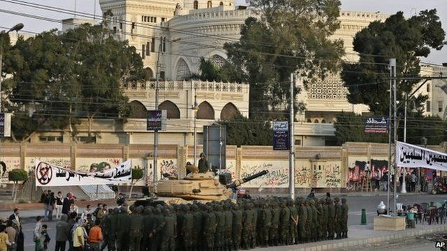 Egyptian army soldiers stand guard in front of the presidential palace in Cairo on 9 December.