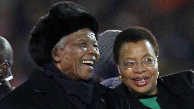 Nelson Mandela and his wife Graca are driven across the field ahead of the World Cup final in July 2010