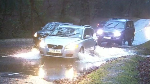 Cars driving through flood water