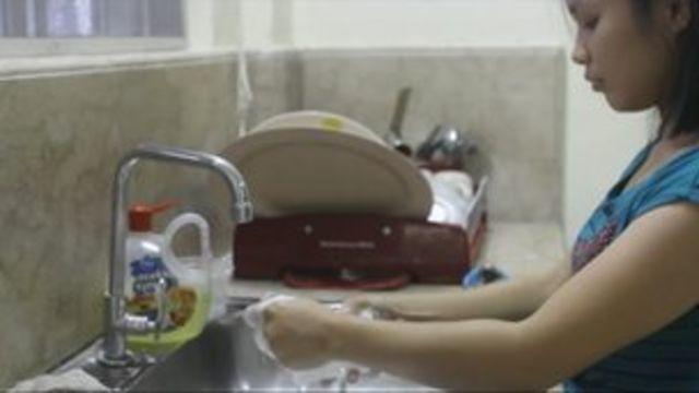Worker washing dishes