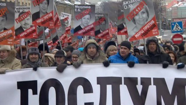 Protesters holding banners in Moscow