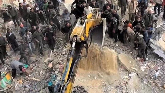 Bulldozer at site of collapsed building