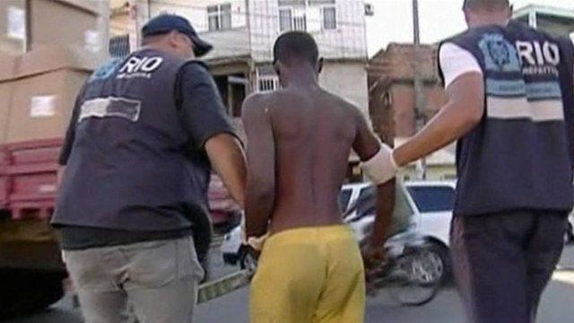 Brazilian officers taking in suspected drug user