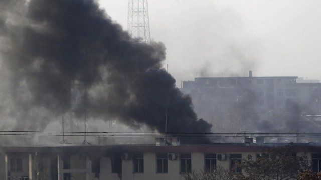 Smoke rises from the Kabul traffic police headquarters during an insurgents' attack on Monday 21 January 2013