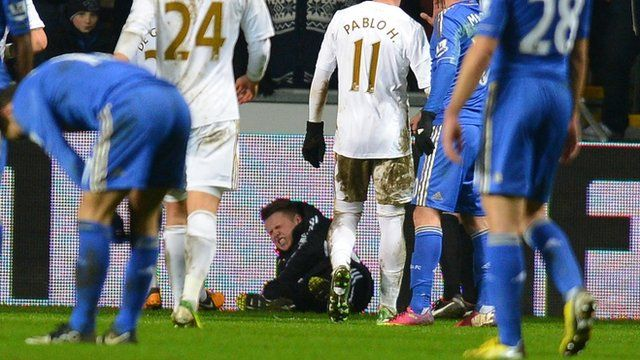 A ballboy lies on the ground after a altercation with Chelsea's Eden Hazard