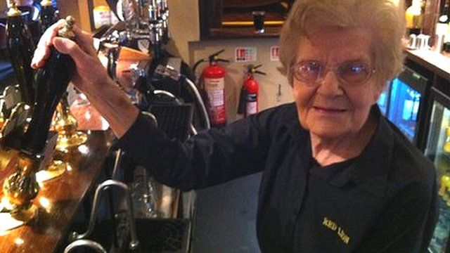 Dolly Saville, believed by her employers to be the oldest barmaid in the world