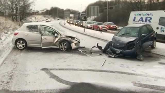 Cars with smashed fronts on icy road, with tailbacks on other carriageway