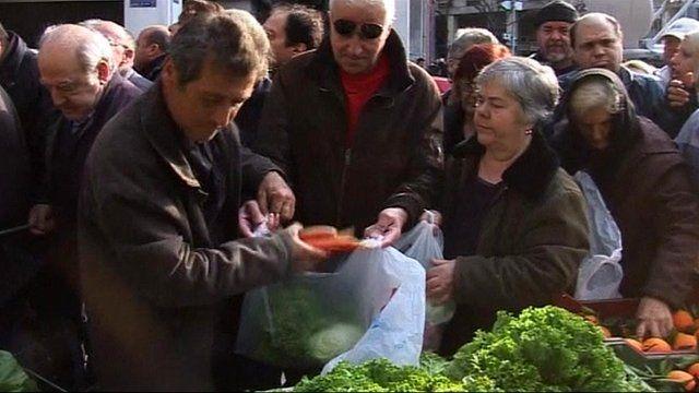 Greek farmers giving away vegetables
