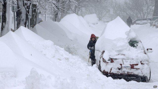 Woman shovels snow