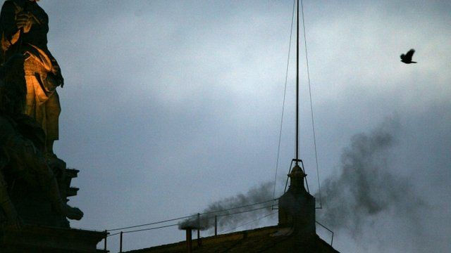 Black smoke rising from chimney of the Sistine Chapel in 2005