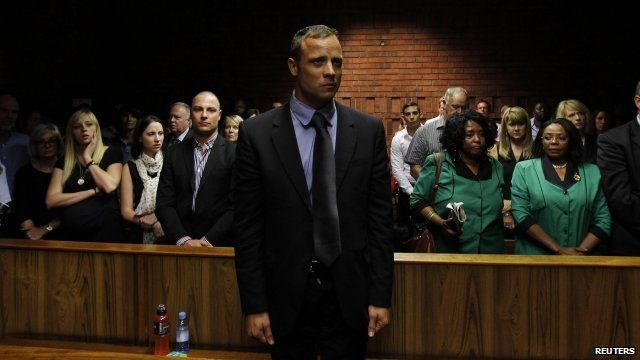 Oscar Pistorius awaits the start of court proceedings in the Pretoria Magistrates court