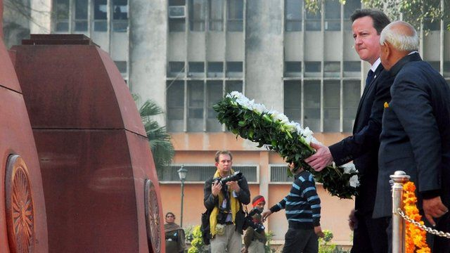 David Cameron placing a wreath at the memorial to the Amritsar massacre