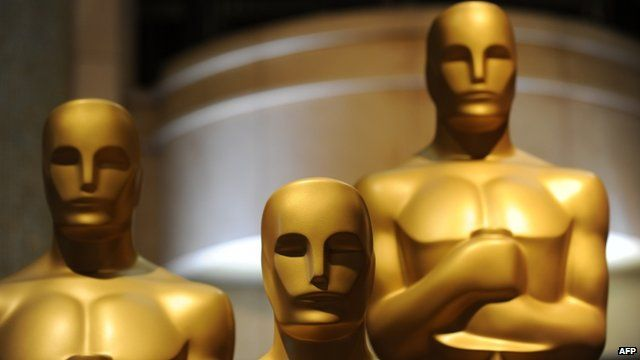 Oscar statues are viewed in preparation one day before the 85th Academy Awards in Hollywood, California