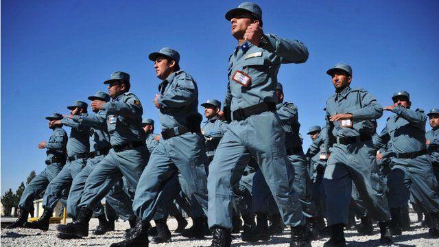 Afghan policemen march