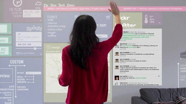 A woman browses the internet on a wall