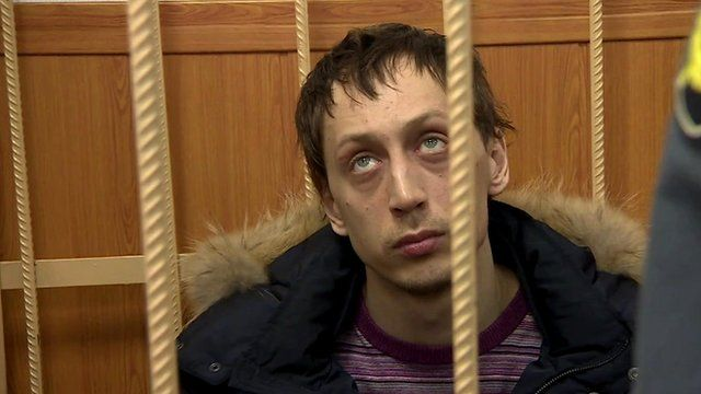 Pavel Dmitrichenko behind bars in courtroom