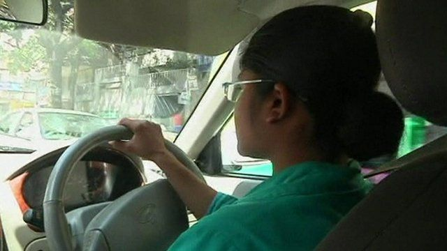 A female Indian cab driver