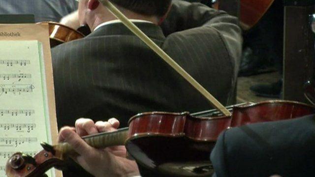 Men playing violins
