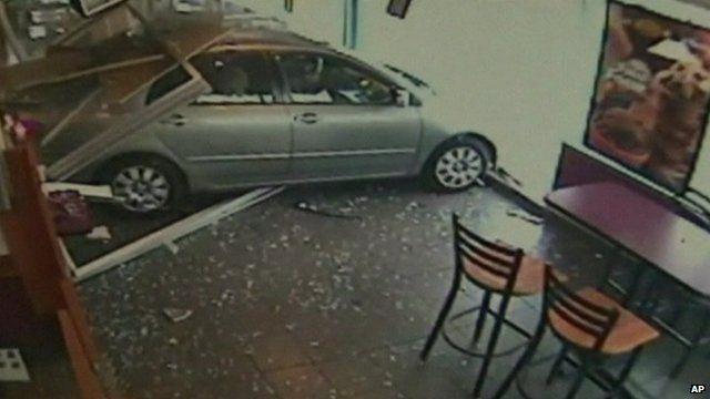 CCTV image of car crashing into Dunkin' Donut branch, Philadelphia