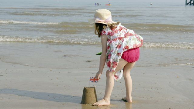 Girl builds sandcastle