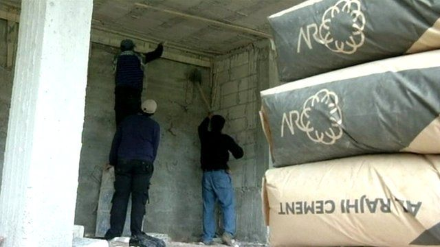 Refugees in Syria working in construction.