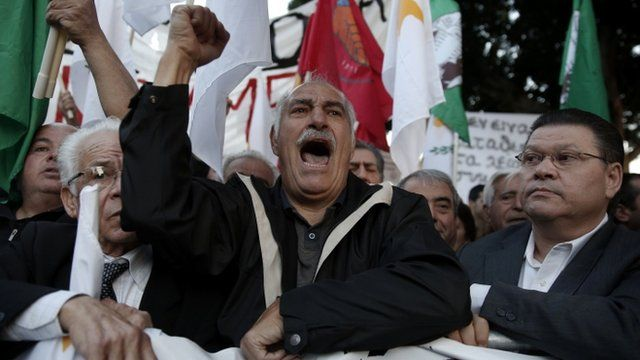 Protesters shout slogans during an anti-bailout rally