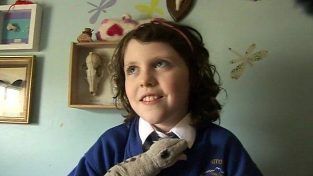 Daisy Morris with a toy dinosaur