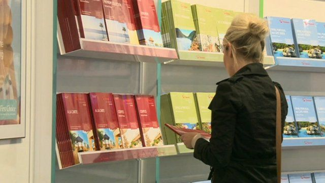 Woman looking at travel brochures