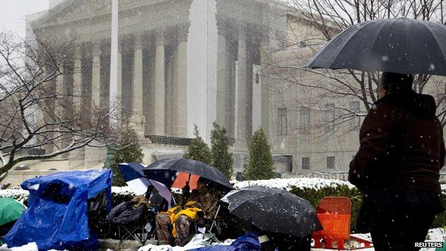 People queuing outside Supreme Court in the snow