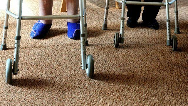 Elderly people on zimmer frames