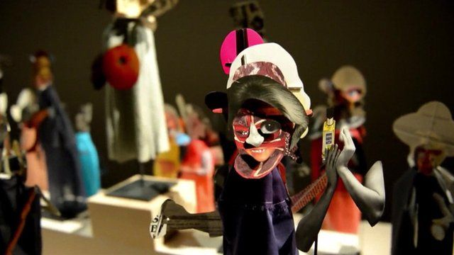 A puppet made of cut-outs from magazines and books on display at London's Barbican centre
