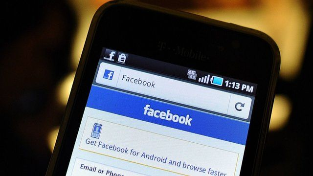 A smartphone displays a Facebook app