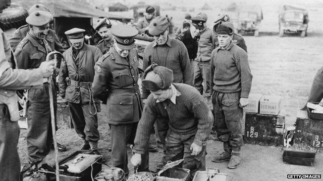 22 December, 1950: An American officer inspects a British cooking area near the front line