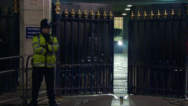 Policeman stands outside gates of Ritz