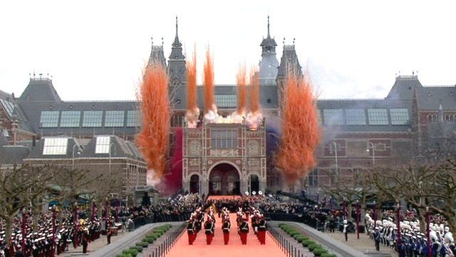 Orange, re, white and blue smoke from fireworks outside the Rijksmuseum