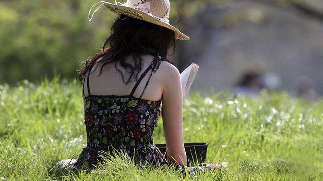 Woman reads a book on Primrose Hill