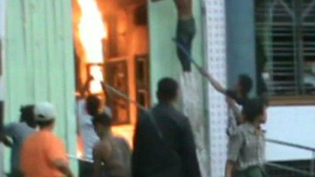 Burmese men attack building