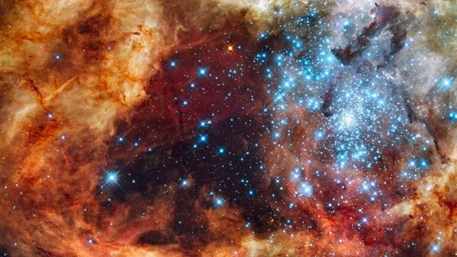 Blue stars wreathed by warm, glowing clouds