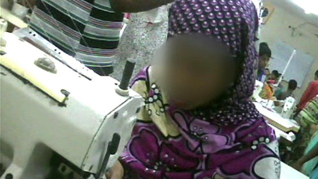 Secret film footage of child at sewing machine