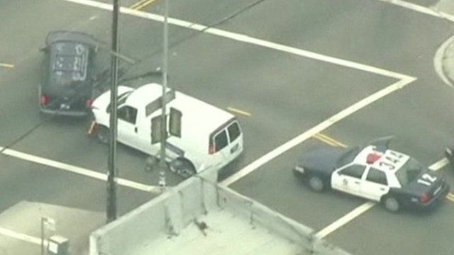 A white van crashes into another vehicle